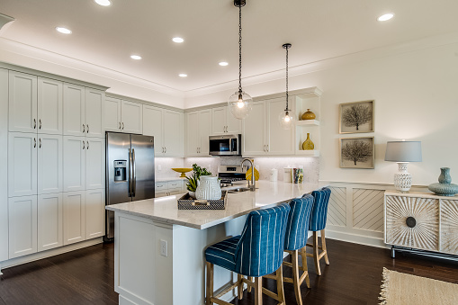 Amenities in new kitchen include pull down faucet and pendant lighting