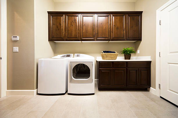spacious laundry room - laundry laundry room stock pictures, royalty-free photos & images