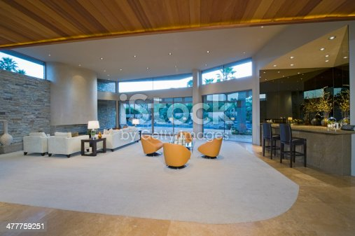 View of a spacious and modern living room by bar area with porch view