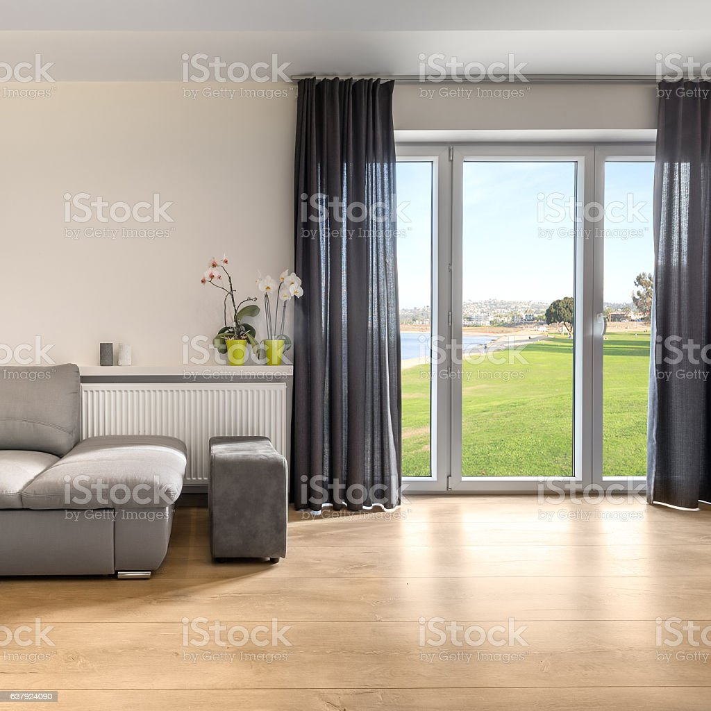 Spacious living room with balcony stock photo