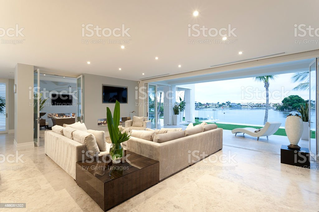 Spacious living room with grey sofas stock photo
