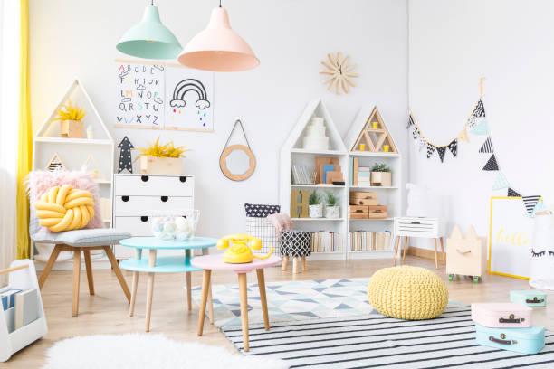 Spacious pastel kid's playroom interior stock photo