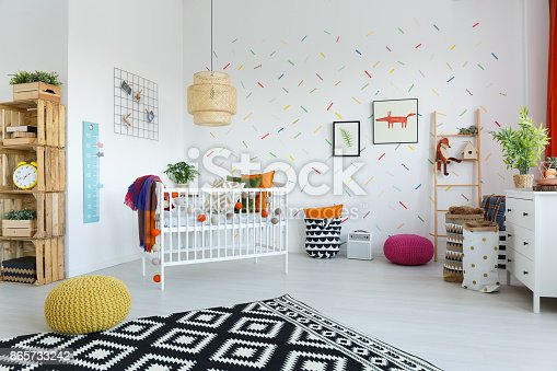 istock Spacious scandi bedroom with cradle 865733242