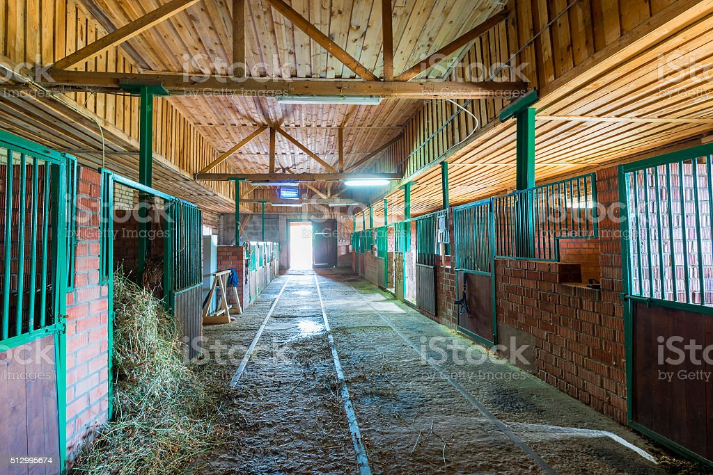 spacious stables empty building in the countryside stock photo