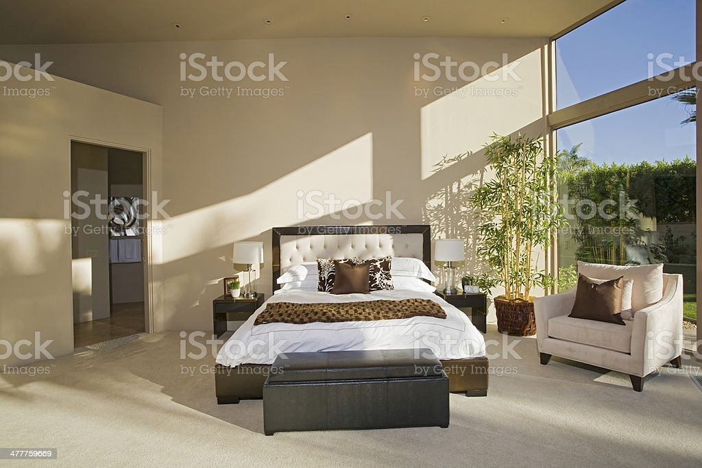 Spacious Sunlit Bedroom royalty-free stock photo