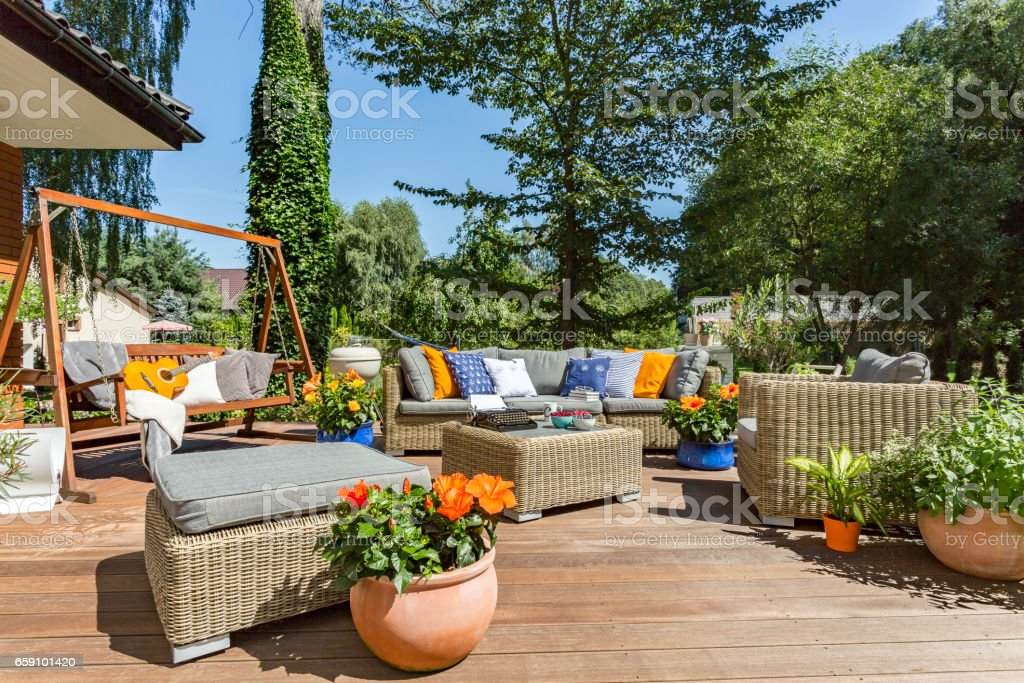 Spacious villa terrace with rattan furniture stock photo