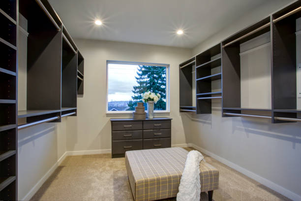 Spacious walk-in closet with clothes rails and shelves. stock photo