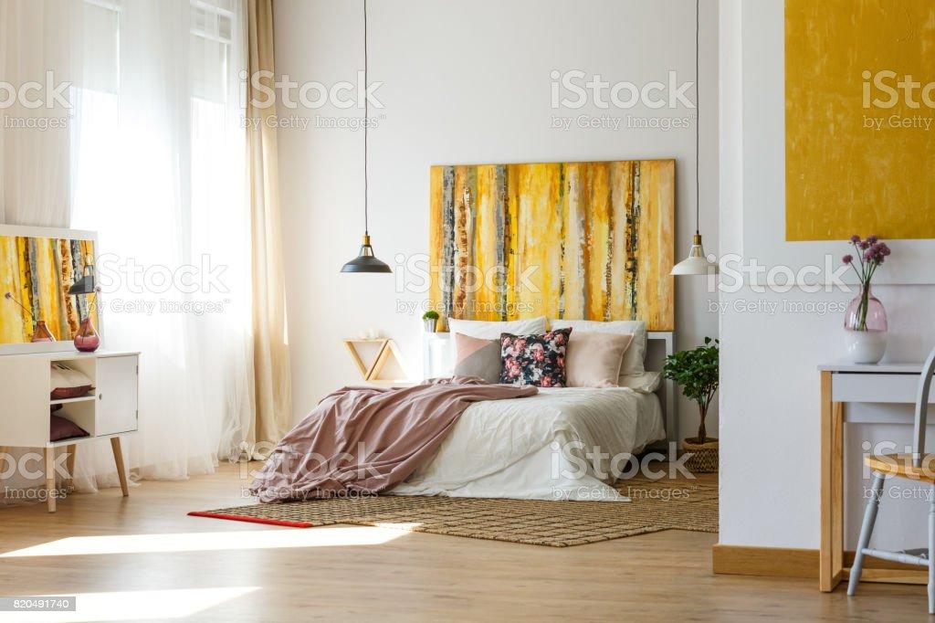 Spacious warm bedroom stock photo