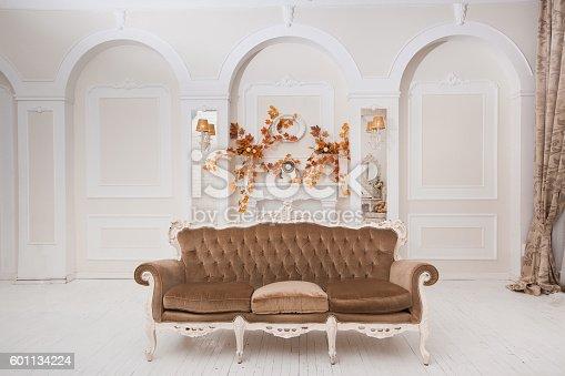 istock Spacious white wedding hall with autumn decoration 601134224