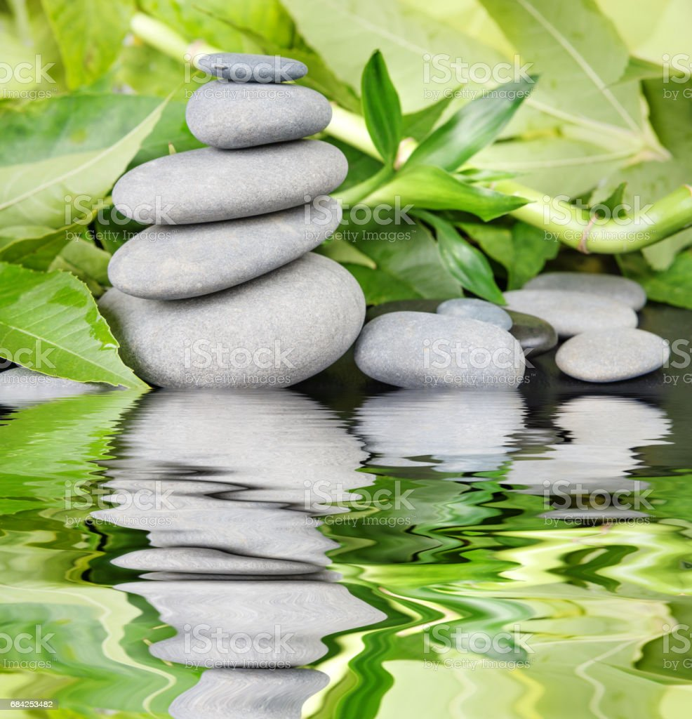 Spa-concept with zen stones and bamboo reflected in a water royalty-free stock photo