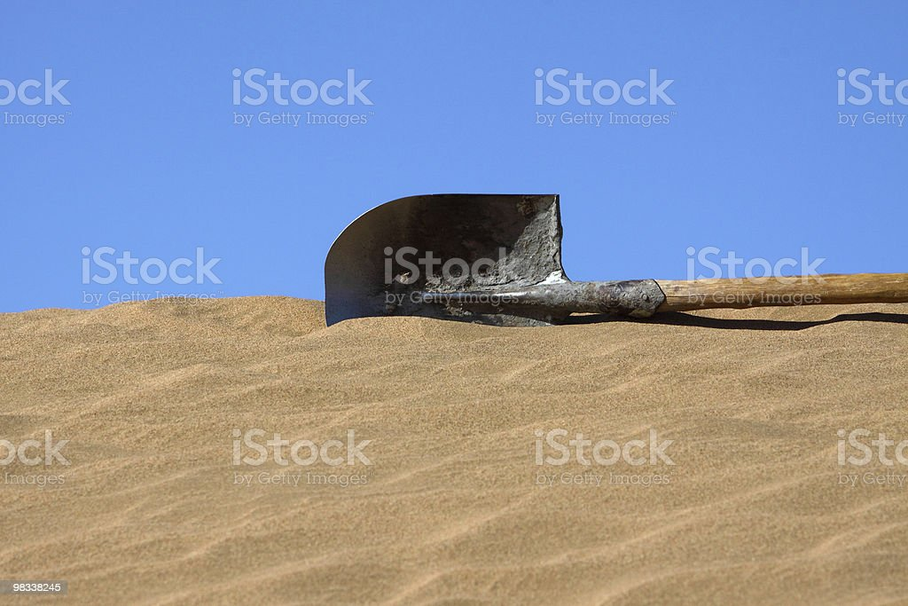spade in sand royalty-free stock photo