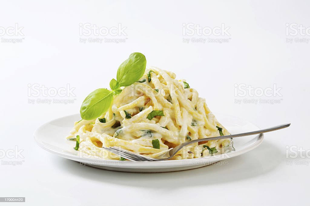 Spaetzle noodles with cheese sauce stock photo