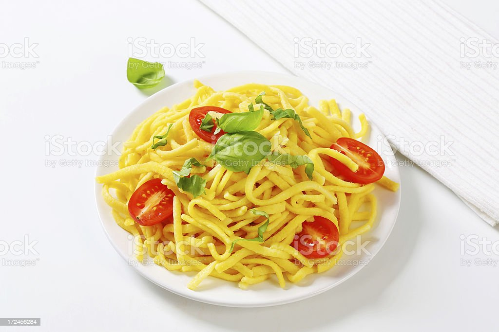 Spaetzle noodles with tomato and basil stock photo