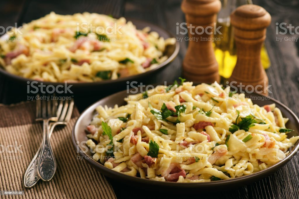 Spaetzle with bacon and onion,german style cuisine stock photo