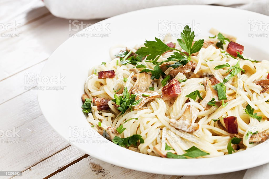 spagetthe with bacon and chanterelle cream royalty-free stock photo