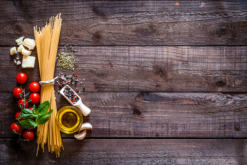 Spagetti with ingredients on rustic wooden table