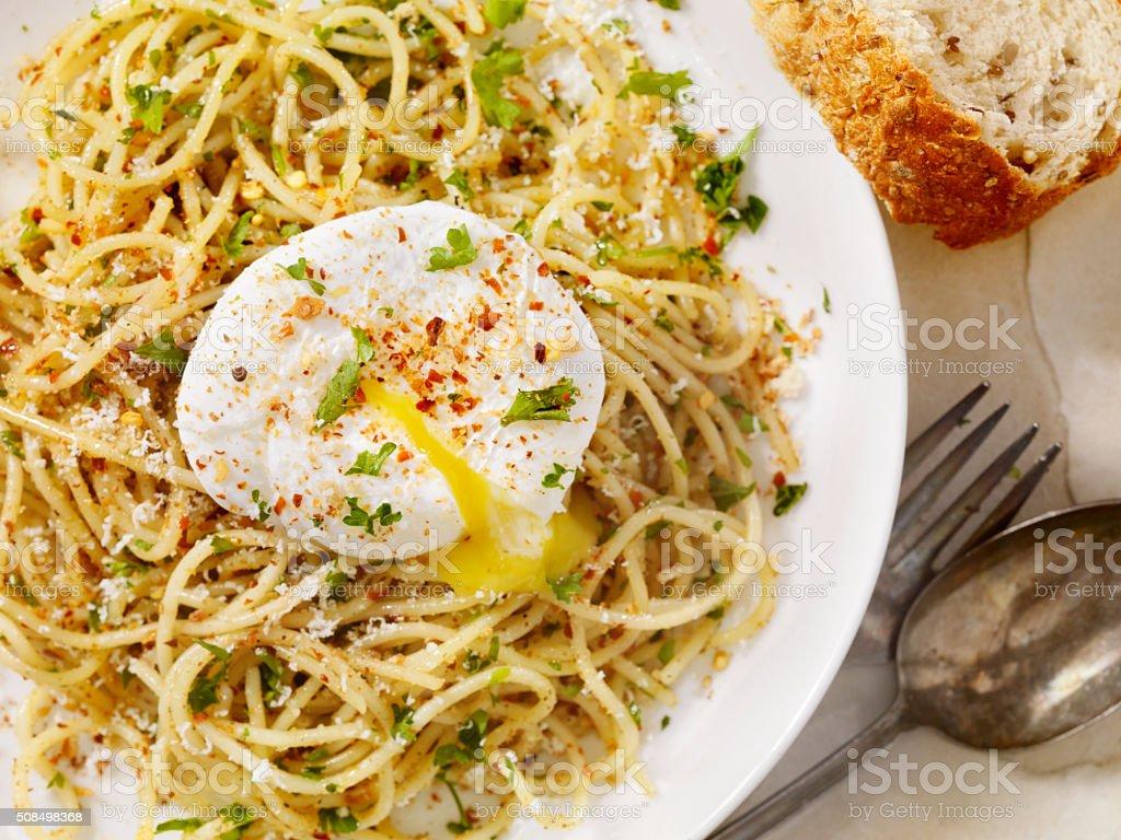 Spaghetti Aglio e Olio With a Poached Egg stock photo