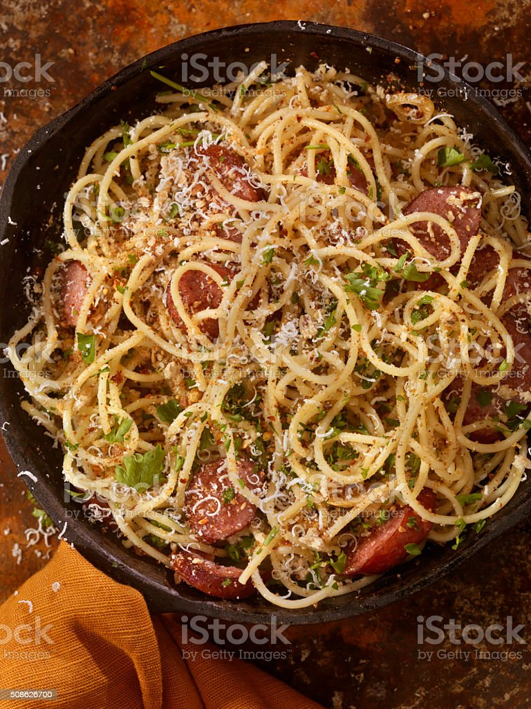 Spaghetti Aglio e Olio With Sausage and Parmesan stock photo