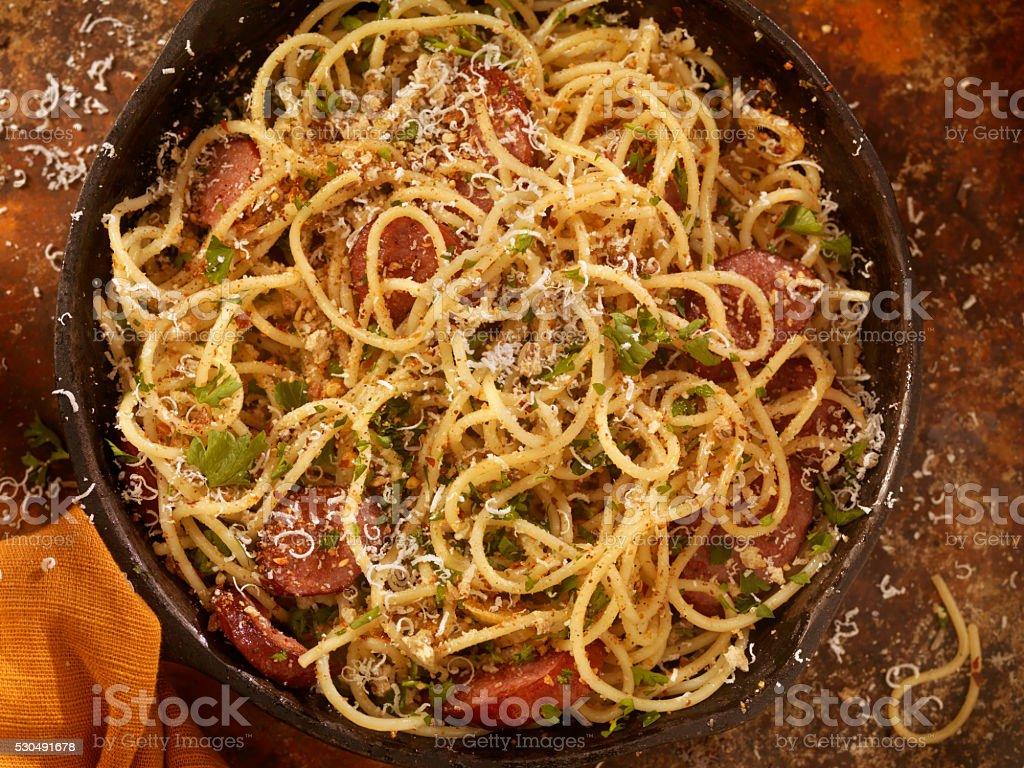 Spaghetti Aglio e Olio With Sausage and Parmesan stock photo