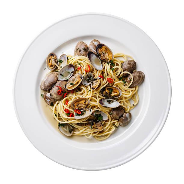 spaghetti alle vongole on white plate isolated - pasta vongole bildbanksfoton och bilder