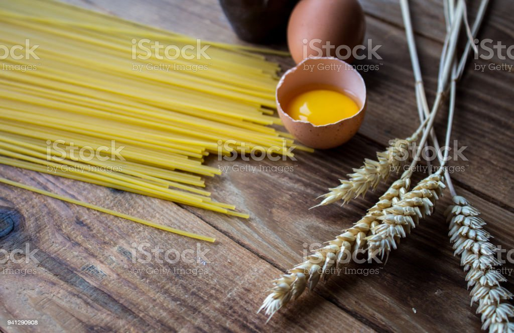 spaghetti and eggs on wooden background stock photo