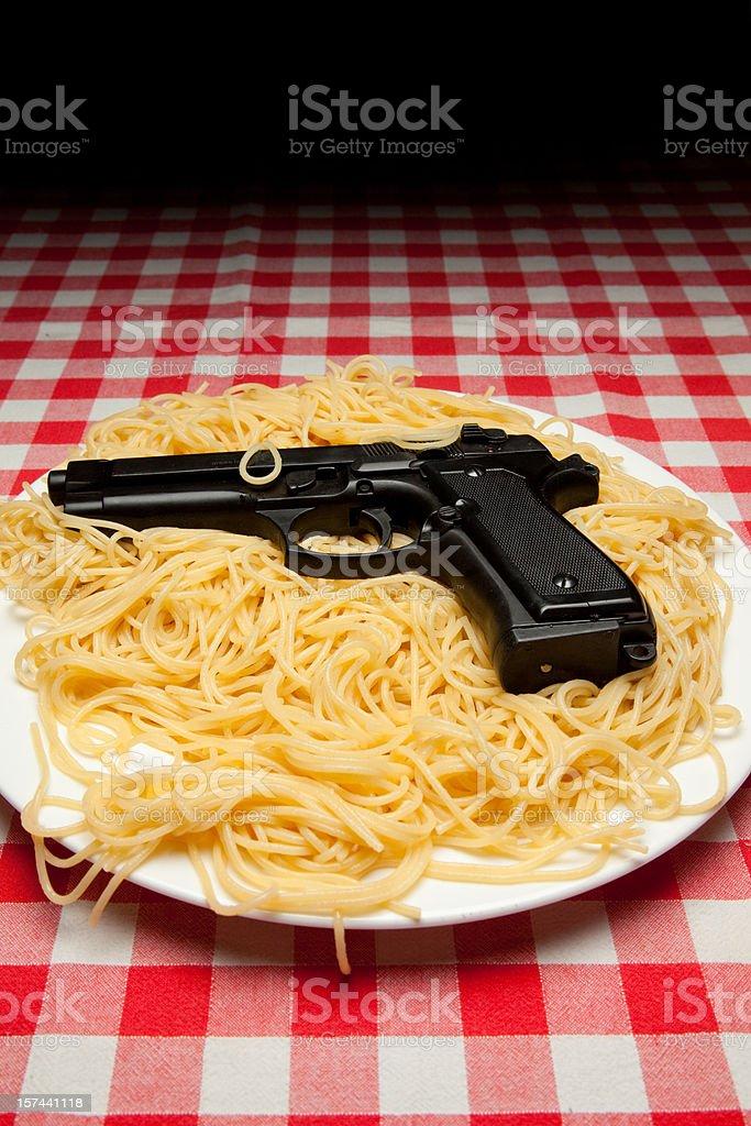 Spaghetti and gun royalty-free stock photo