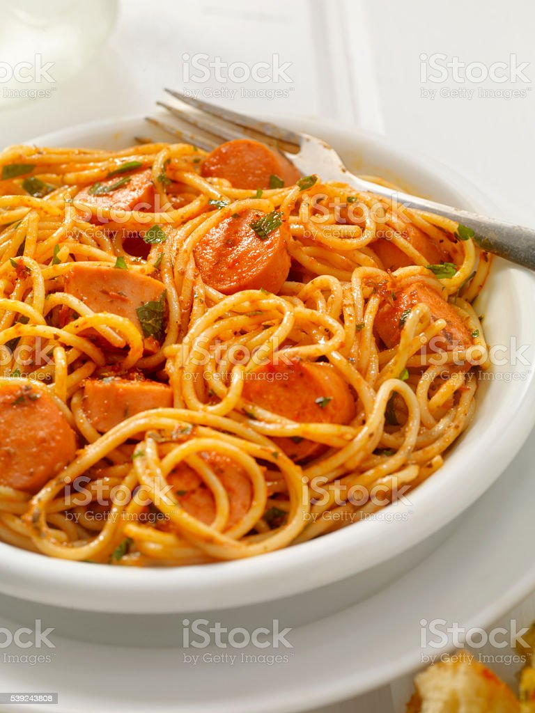 Spaghetti and Hotdogs in Tomato Sauce royalty-free stock photo