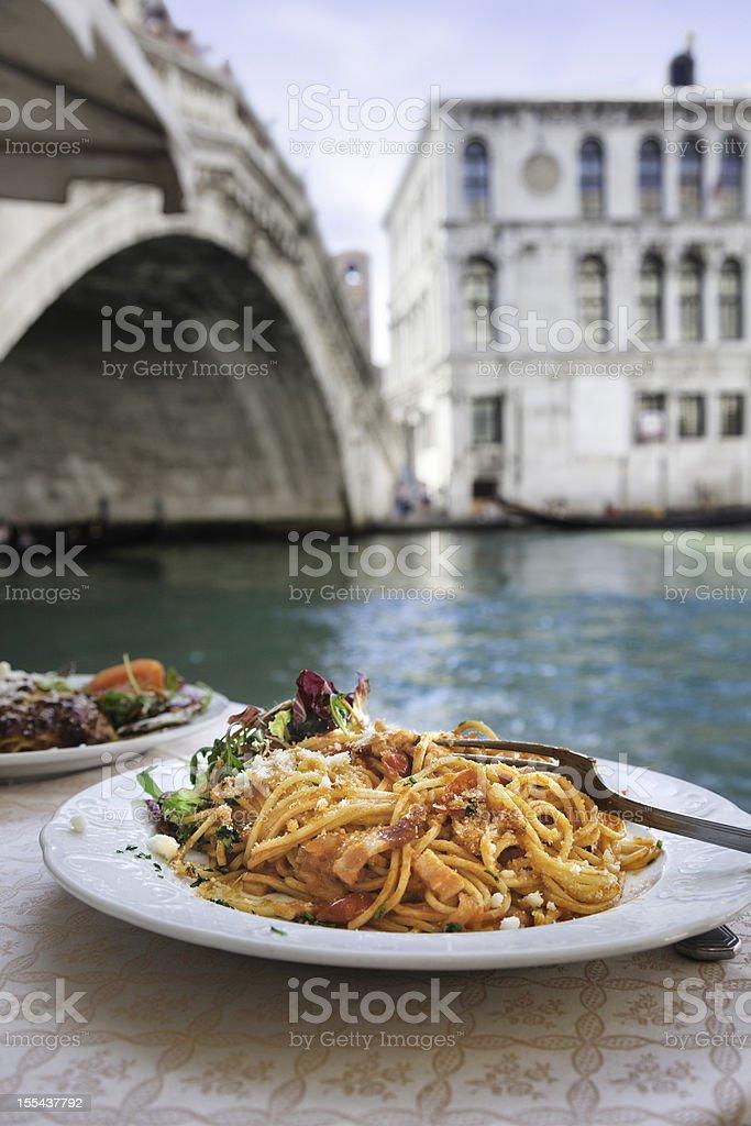 Spaghetti at the Rialto Bridge, Venice. stock photo