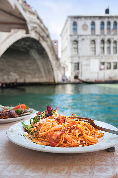 Spaghetti at the Rialto Bridge, Venice. stock photo