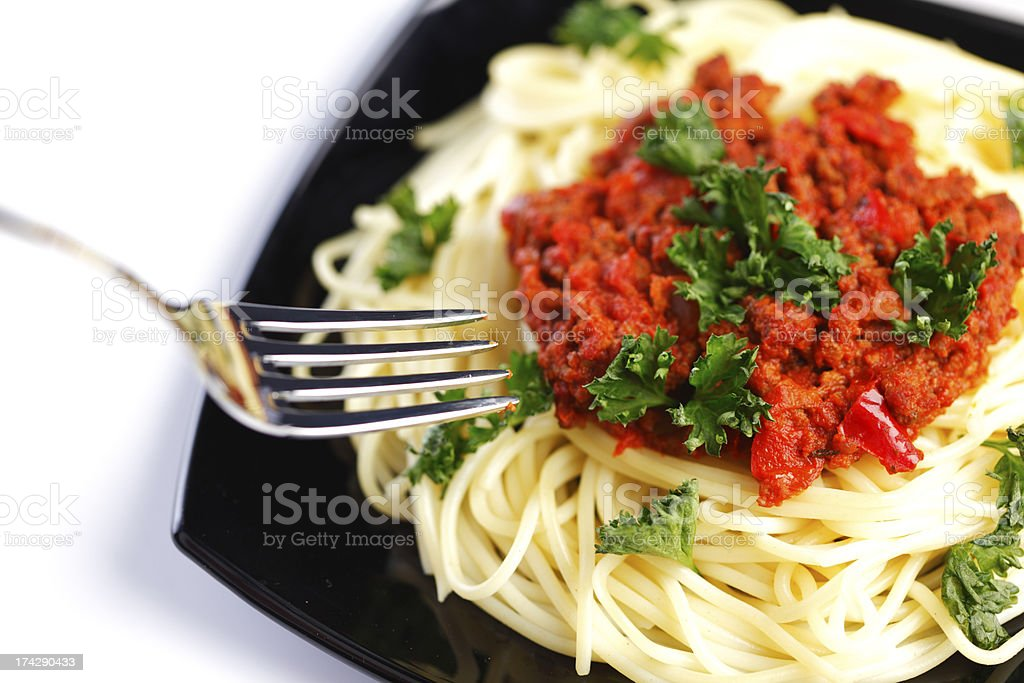 Spaghetti bolognese and fork royalty-free stock photo