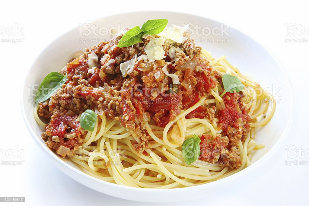 Spaghetti Bolognese in a white bowl stock photo