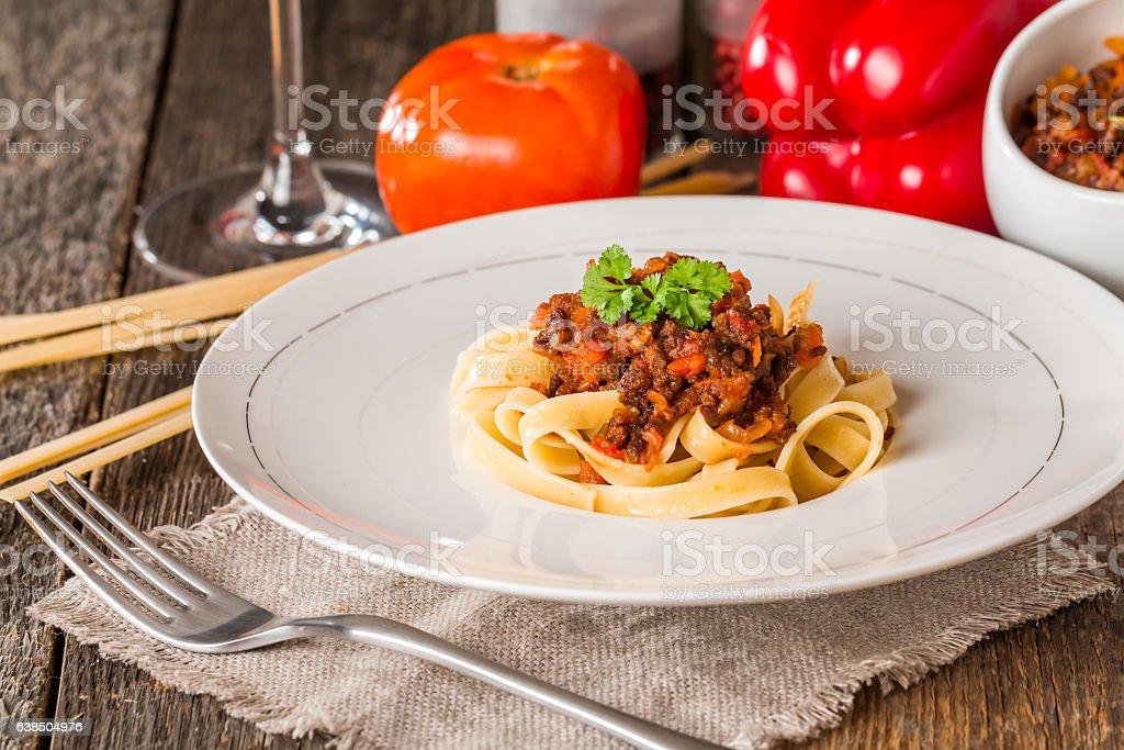 Spaghetti Bolognese on white plate stock photo