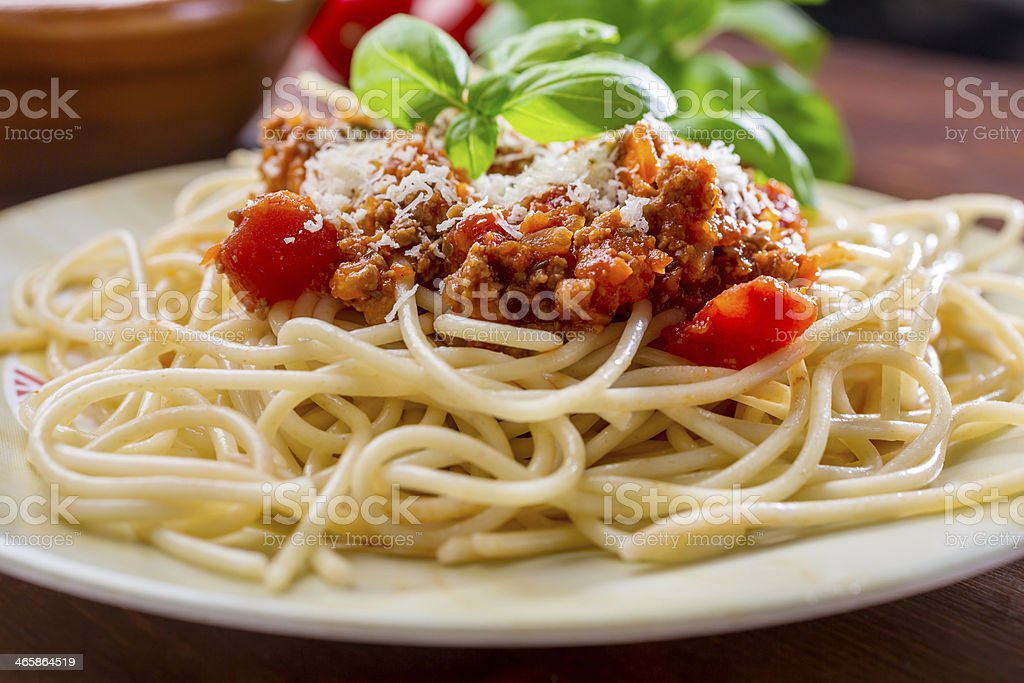 Spaghetti Bolognese with cheese and basil stock photo
