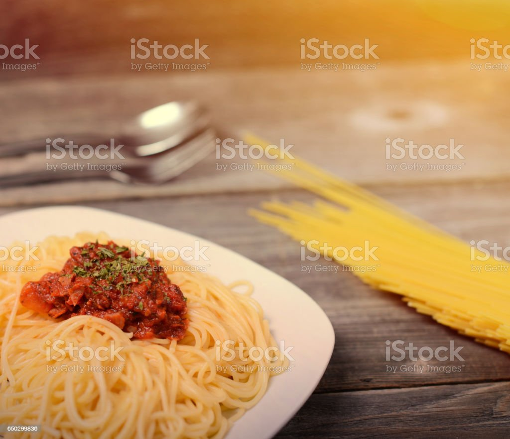 Spaghetti Bolognese With Tomato Beef Sauce And Raw Pasta On