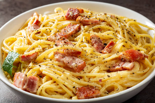 Spaghetti carbonara in white bowl stock photo