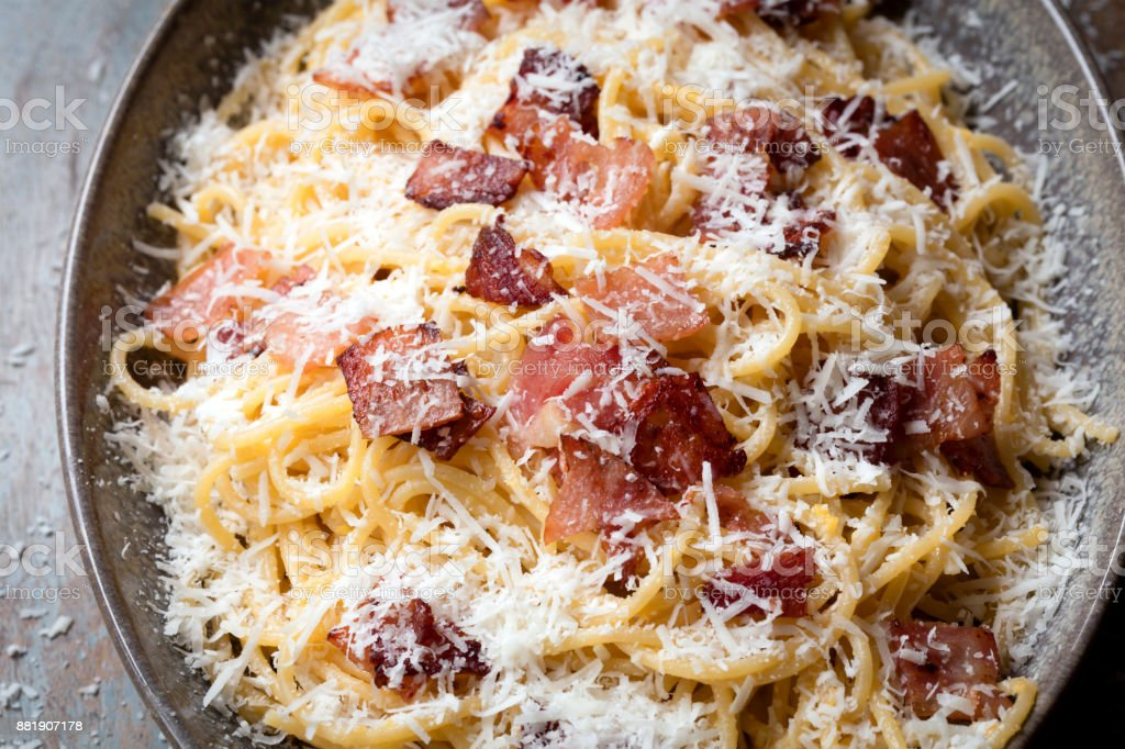 Spaghetti Carbonara on Rustic Timber Table stock photo