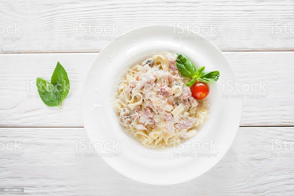 Spaghetti carbonara on white wooden background stock photo