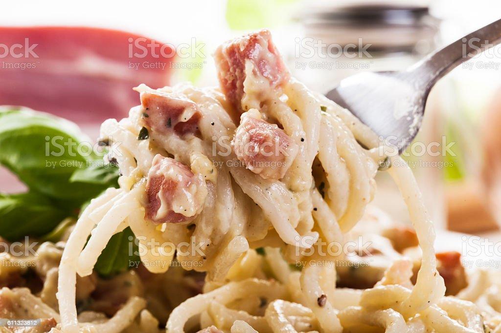 Spaghetti carbonara with bacon and basil stock photo