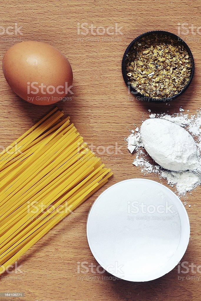 Spaghetti, egg, flour, oregano species royalty-free stock photo