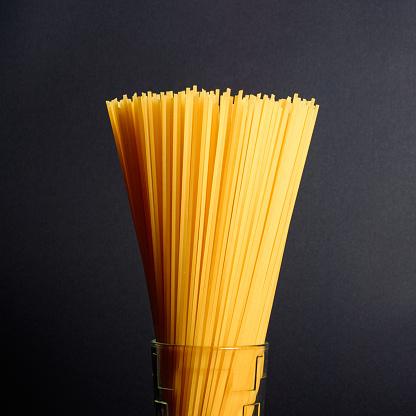 Type of Italian pasta: spaghetti. Spaghetti on a white plate.