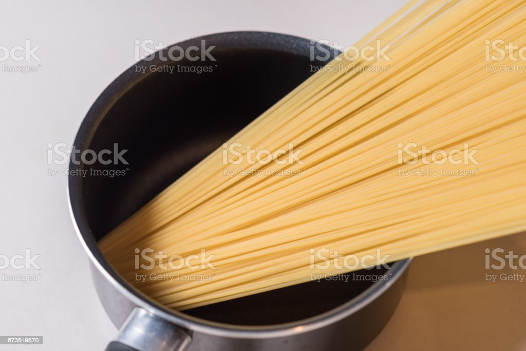 Spaghetti in a pot royalty-free stock photo