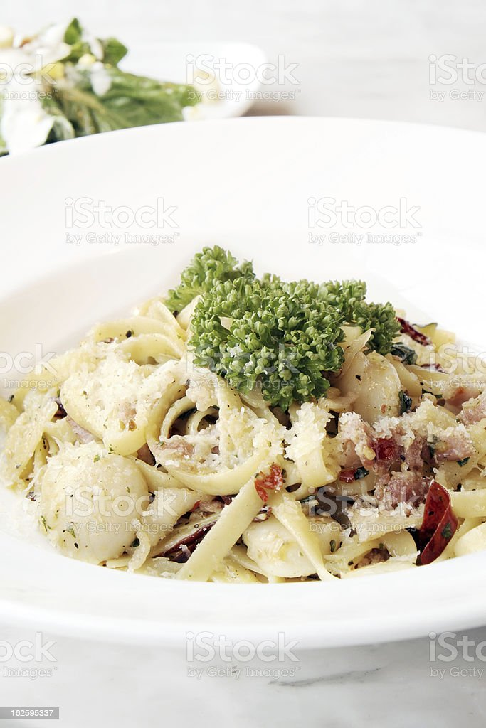 Spaghetti in a spicy scallop. royalty-free stock photo