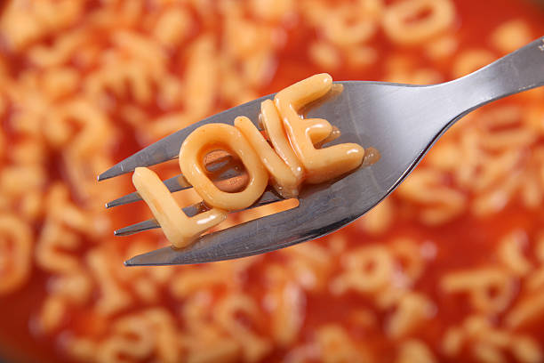 Spaghetti letters spelling the word Love. stock photo