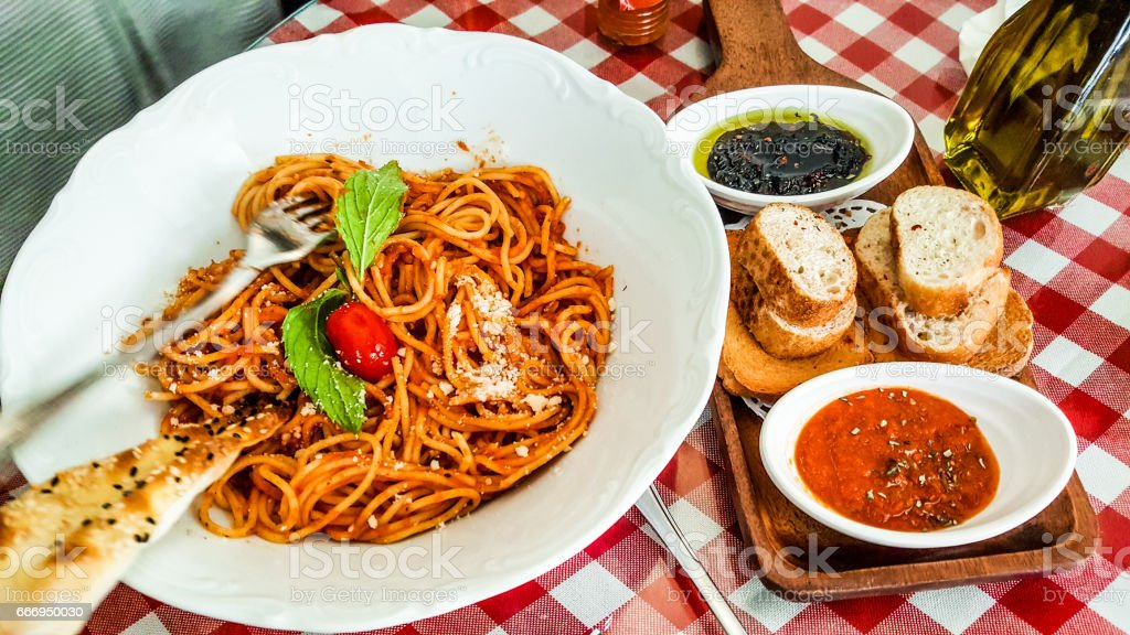 Spaghetti napolitan or bolognese served with tomato and olive paste. stock photo