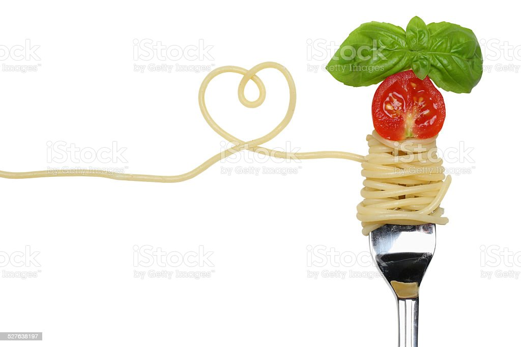 Spaghetti noodles pasta meal with heart on fork love topic stock photo