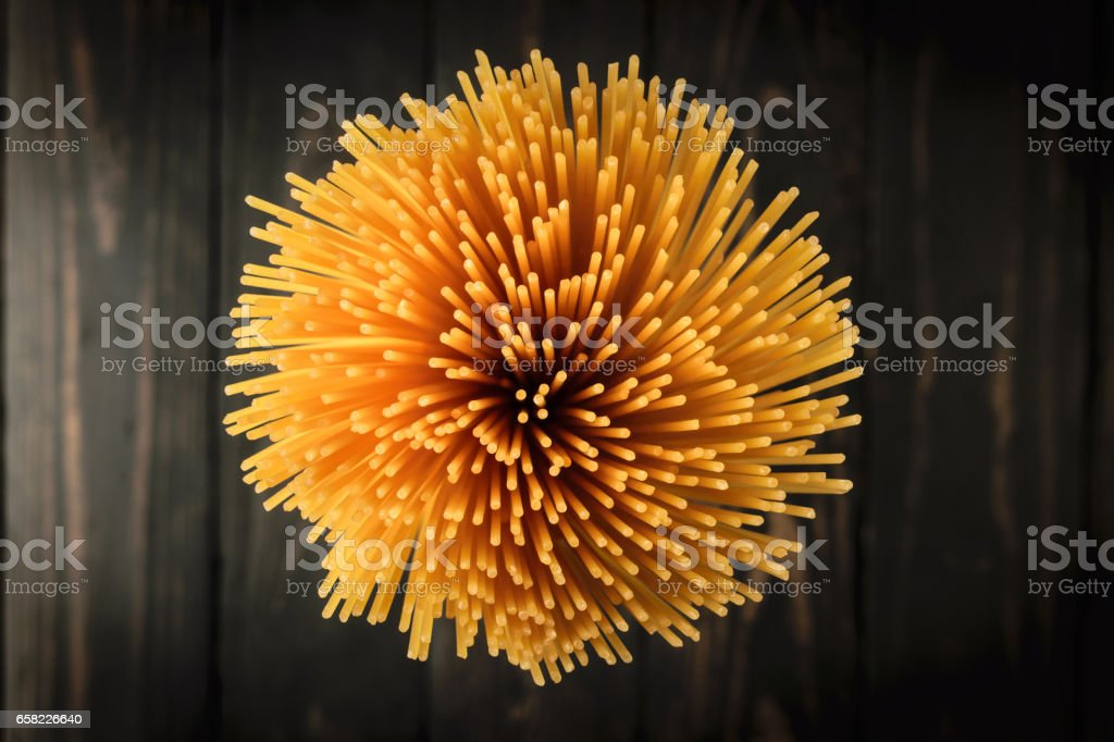 spaghetti on back wooden background stock photo