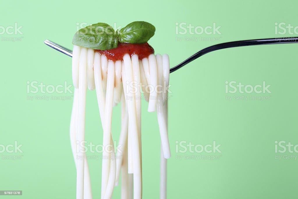 Spaghetti on Spoon Green royalty-free stock photo