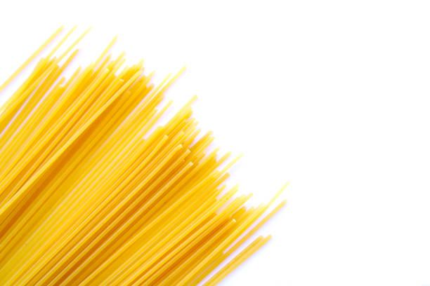 spaghetti pasta on white background spaghetti pasta on white background uncooked pasta stock pictures, royalty-free photos & images