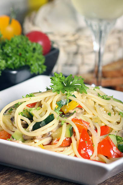 Spaghetti pasta A dish of fresh pasta primavera in white plate primavera stock pictures, royalty-free photos & images