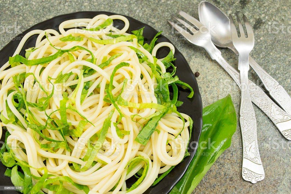Spaghetti pasta with wild garlic royalty-free stock photo